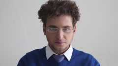 Serious young businessman in glasses Stock Footage