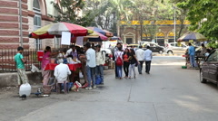People at the street market while car passing by in suburb of Mumbai. Stock Footage