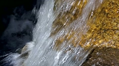 Close view of fast moving water over rocks - stock footage