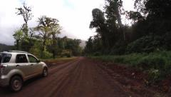 Tropical valley dirt road Stock Footage