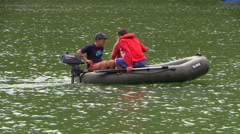 Teens swim in a dinghy on a mountain lake Mangup. Crimea. Stock Footage