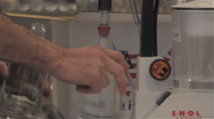 Gin Bottle Being Filled At Distillery Stock Footage