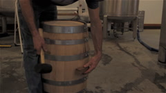 Knocking Loose the Wiskey Barrel Plug at a Distillery Stock Footage