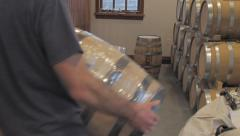 Stock Video Footage of Stacking Liquor Barrels at a Distillery