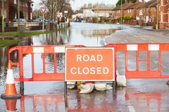 Warning Traffic Sign On Flooded Road - stock photo