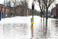 Flooded Urban Road With Traffic Lights Stock Photos