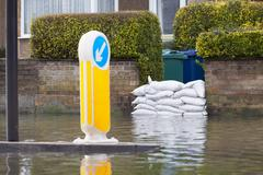 Sandbags Outside House On Flooded Road Stock Photos