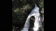 Rainforest waterfall in shadow and sunlight (3097) Stock Footage