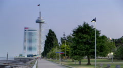Walk near Hotel Tower in the Park of the Nations with ebb-tide timelapse from - stock footage