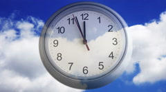 Time lapse of a clock over clouds Stock Footage