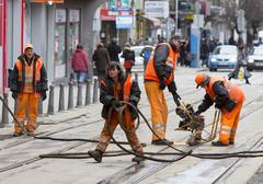 Tram road workers repair repairing Stock Photos