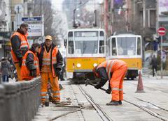 Tram road workers repair repairing hummer Stock Photos