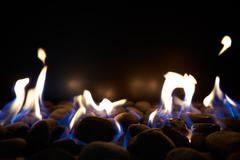 Close Up Of Flaming Coals On Gas Fire - stock photo