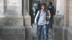 Indian teenage boys walking out of building. Stock Footage