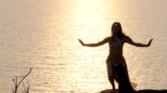 Silhouette of a dancer dancing at sunset Stock Footage
