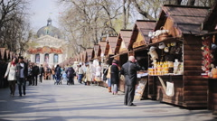 People walk on a European city at the weekend Stock Footage