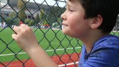 Child watching football match 2 - stock footage