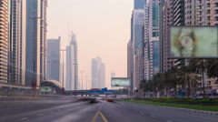 Buisness district of Dubai the Shiekh Zayed road at sunset time, UAE timelapse - stock footage