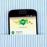 Hangouts app on the Samsung galaxy display - stock photo