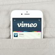IPhone 6 displaying Vimeo application Stock Photos