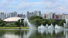 Fountains with skyline in Ibirapuera Park, Sao Paulo, Brazil Stock Footage