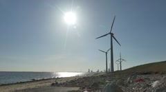 Industry, beach  and wind turbines Stock Footage