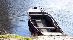 Rowboat on the riverbank - stock footage
