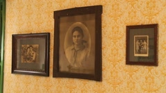 Old photographs on the wall Stock Footage