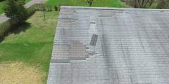 4K damage roof orbit left Stock Footage