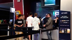 People line up for buying movie ticket at cineplex Stock Footage
