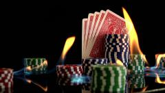 Flames chips playing cards poker royal flush black background fire heat heart Stock Footage