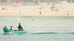 KAMALA, PHUKET, THAILAND - CIRCA DEC 2014: Local fisherman crossing frame in Stock Footage