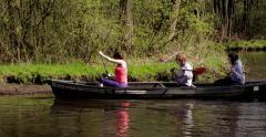 Three girls unhandy canoeing Netherlands 4K Stock Footage