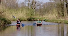 Two boys canoes canoeing Netherlands Stock Footage