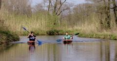 Two boys in kayaks kayaking Netherlands Stock Footage