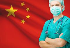 Surgeon with national flag on background - People's Republic of China - stock photo