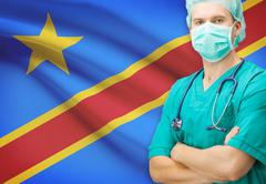 Surgeon with national flag on background - Democratic Republic of the Congo - stock photo