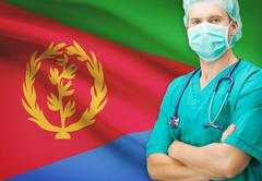 Surgeon with national flag on background - Eritrea - stock photo