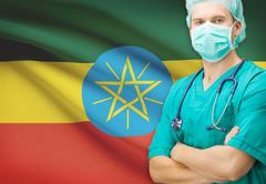 Surgeon with national flag on background - Ethiopia Stock Photos