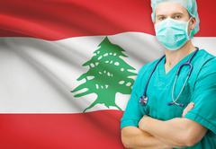 Surgeon with national flag on background - Lebanon - stock photo