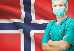 Surgeon with national flag on background - Norway - stock photo