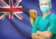 Surgeon with national flag on background - Turks and Caicos Islands - stock photo