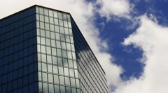 Time-lapse of a reflective building with fast cloud movement Stock Footage