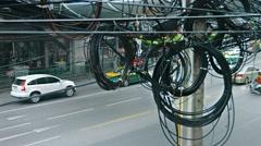 BANGKOK, THAILAND - CIRCA FEB 2015: Messy, spaghetti-like coils of telephone Stock Footage