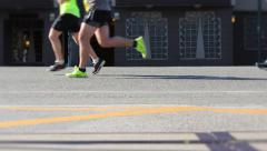 Group of Marathon Runners feet in Slow Motion on Sunny Day Stock Footage