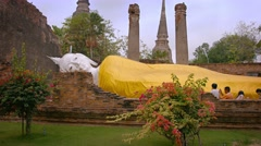 AYUTTHAYA, THAILAND - CIRCA FEB 2015: Enormous Buddha Statue, Lying on its Si Stock Footage