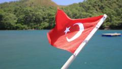 Blue voyage with Turkish Flag waving on the stern of a cruise yacht Stock Footage