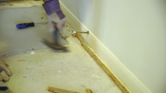 DIY demolition project of carpet tack strips by homeowner - stock footage