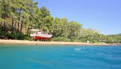 Marmaris Kamp Amazon with a tourist boat on the beach in maintenance Stock Footage