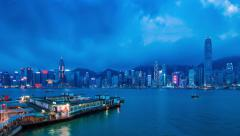 Time-lapse of Hong Kong's Victoria Harbour at blue hour Stock Footage